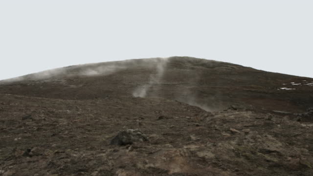 Steam flows from geothermal vents in the ground.