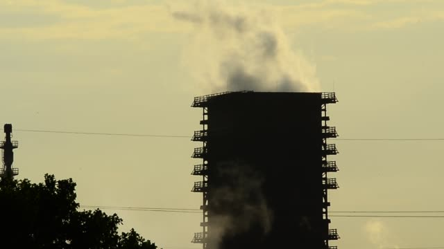 steam from a cooling tower rises up to the sky at thyssenkrupp schwelgern steel plant on may 30 2018 in duisburg germany the european union and the... - ruhr stock videos & royalty-free footage