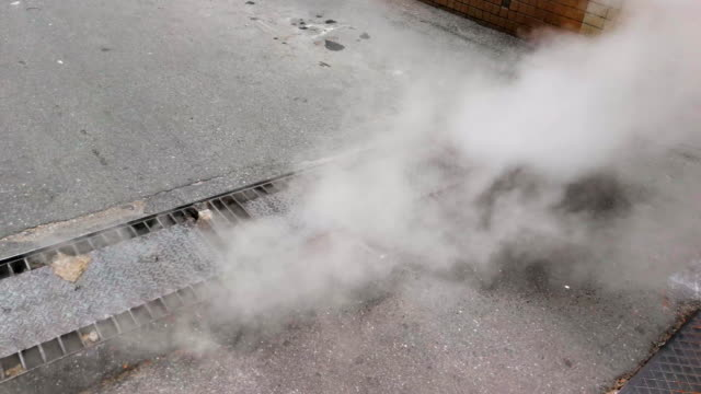 steam from drain - asfalto video stock e b–roll