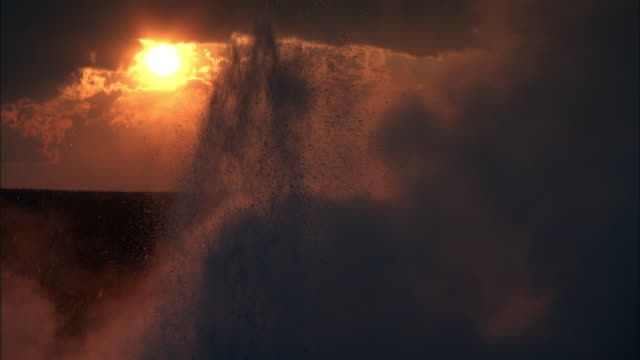Steam from erupting geyser at sunset, Yellowstone, USA