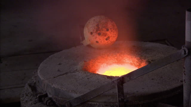 steam from molten metal in a furnace rises near a ladle at a foundry. - ladle stock videos & royalty-free footage