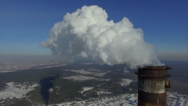 steam from the 270-meter chimney bright frosty winter day. left sideward flight along the steam - smoke stack stock videos and b-roll footage