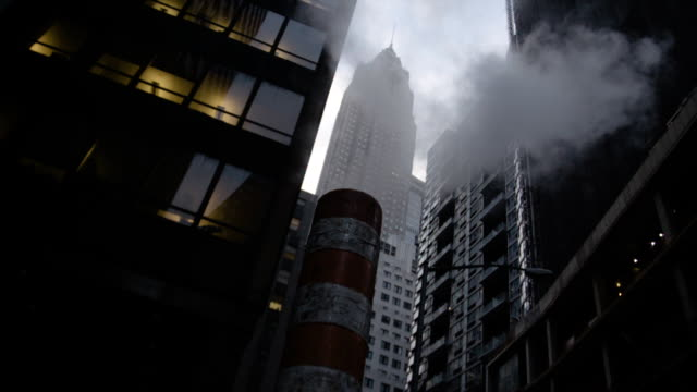 steam from the cold new york streets and skyscrapers - ドラム容器点の映像素材/bロール