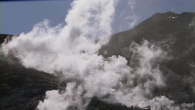 WS Steam issuing from hydrothermal vents on rugged mountainside / Sapporo, Hokkaido, Japan