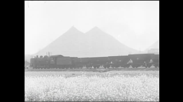 A steam locomotive carries coal across the Chikuho Coal Field in Fukuoka, Japan.