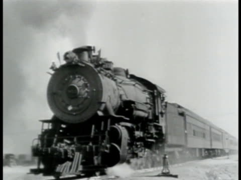 vídeos de stock, filmes e b-roll de locomotive steam locomotive pulling passenger train cars moving on tracks closer larger - 1943