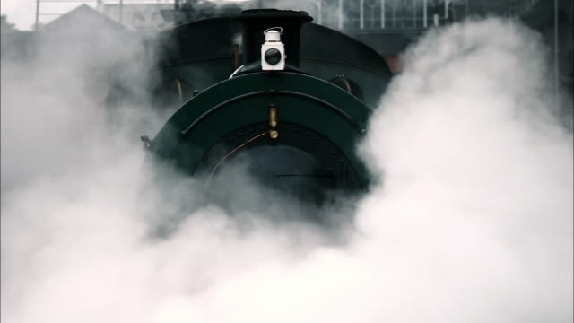 a steam locomotive running in london - locomotive stock videos & royalty-free footage