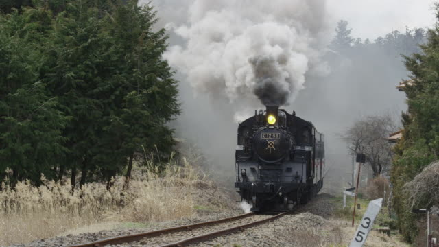 steam locomotive travelling with black smoke in japan - locomotive stock videos and b-roll footage