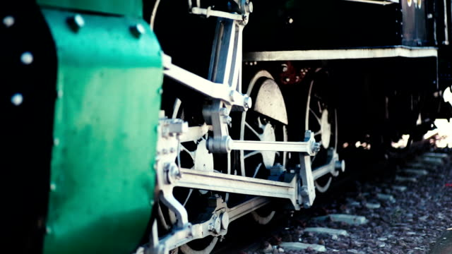 steam locomotive wheels in the exhibition in the rail yard in chiang mai, thailand. - the past stock videos and b-roll footage