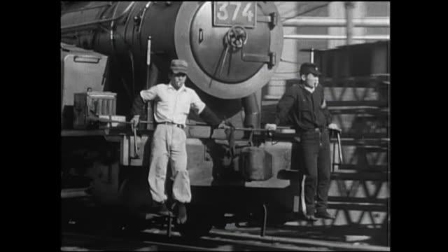 steam locomotives pass each other in an industrial area in kitakyushu, japan. - locomotive点の映像素材/bロール