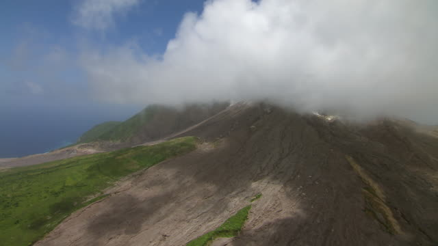 Steam mixing with low clouds over SoufriËre Hills Volcano on Montserrat.