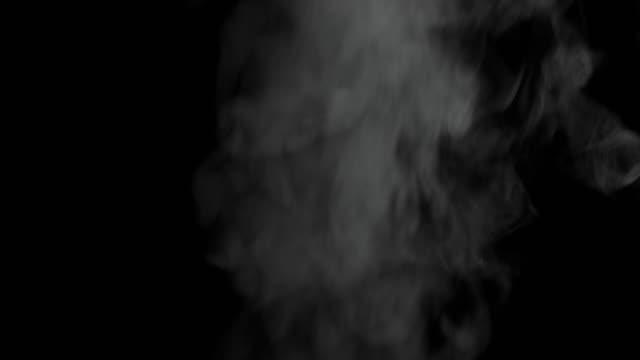 4K: Steam on black background