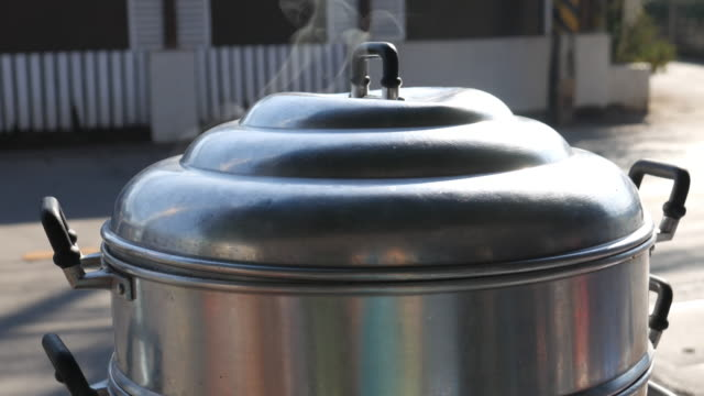 4K : Steam on pot in kitchen, close up