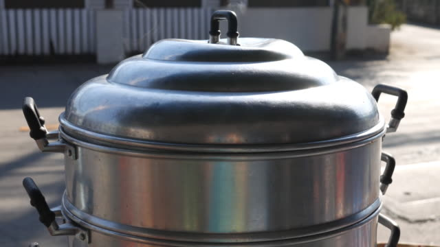 4k : steam on pot in kitchen - kitchenware department stock videos and b-roll footage