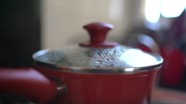 steam over cooking pot in kitchen - lid stock videos & royalty-free footage