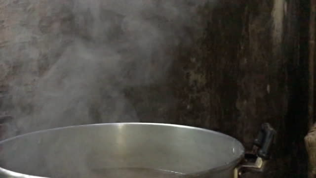 steam over cooking pot - soup stock videos & royalty-free footage