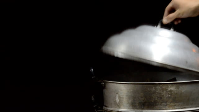 steam over cooking pot,Dolly shot