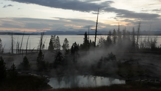 steam over west thumb geyser basin and lake, yellowstone - september stock videos and b-roll footage