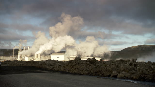 steam plumes into the air from the svartsengi geothermal power planet near the blue lagoon. available in hd - reykjavik stock videos and b-roll footage