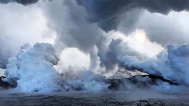 steam plumes rise as lava enters the pacific ocean after flowing to the water from a kilauea volcano fissure on hawaii's big island on may 20 2018... - lava stock videos & royalty-free footage