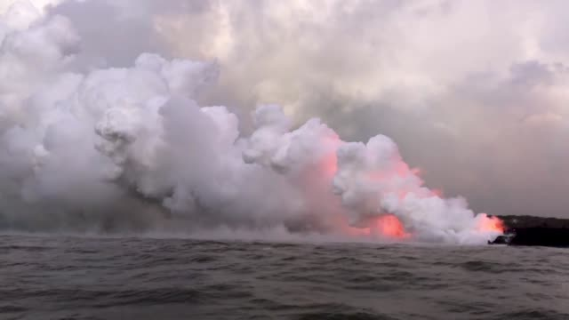 Steam plumes rise as lava enters the Pacific Ocean after flowing to the water from a Kilauea volcano fissure on Hawaii's Big Island on May 20 2018...