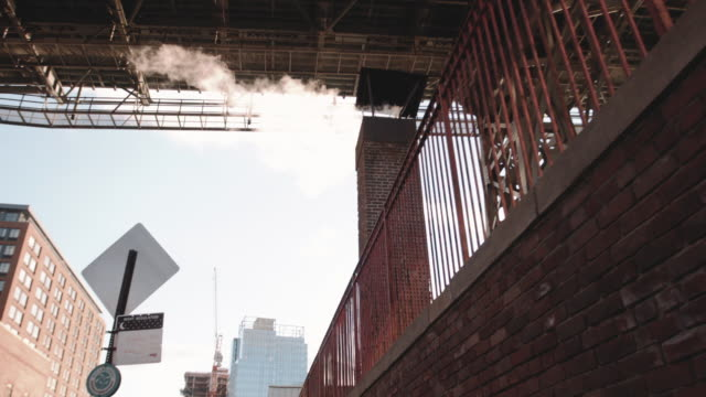 Steam pouring out onto the streets of Brooklyn on a cold winter morning