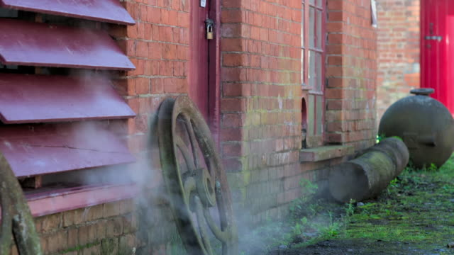 steam pours from a victorian mill - condensation stock videos & royalty-free footage