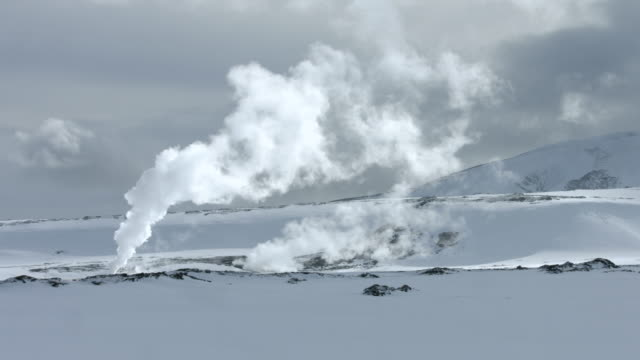 steam pours from thermal vents on the snaefellsnes peninsula in iceland.  - hot spring stock videos & royalty-free footage