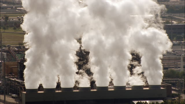 Steam pours out of towers at a power plant in Louisiana.