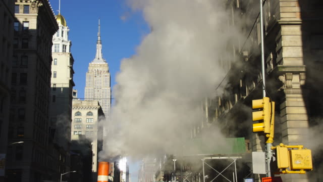 steam rises and drifts among the fifth avenue buildings in the wintertime at midtown manhattan new york city ny usa on jan. 03 2019. - steam stock videos & royalty-free footage