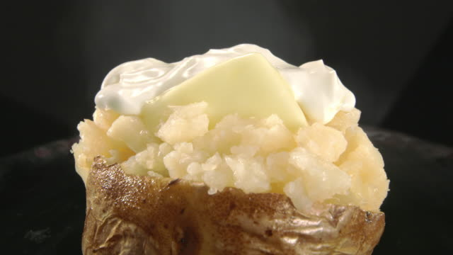 steam rises from a baked potato. - sour cream stock videos and b-roll footage