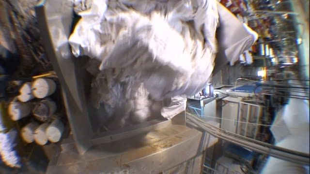 steam rises from a bin of laundry. - launderette stock videos & royalty-free footage