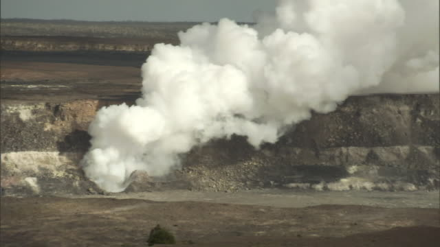steam rises from a crater. - shrubland stock videos & royalty-free footage