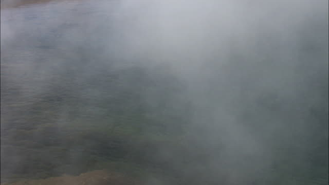 steam rises from a geothermal pool. available in hd. - steam stock videos & royalty-free footage