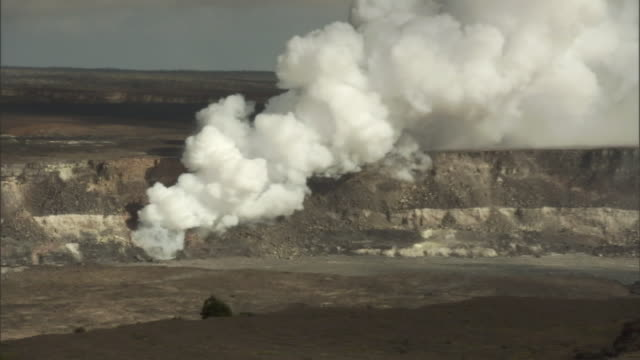 steam rises from a hole in a crater. - shrubland stock videos & royalty-free footage