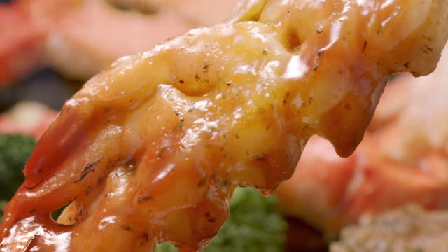 steam rises from a stack of scampi. - scampi seafood stock videos and b-roll footage