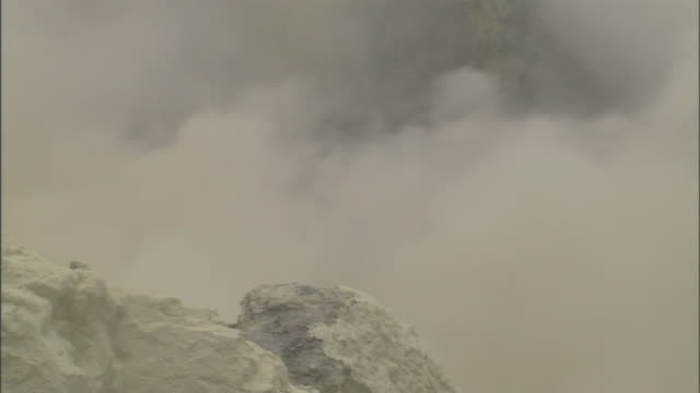 steam rises from a sulfurous vent. - sulphur stock videos & royalty-free footage
