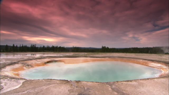 steam rises from a thermal pool in yellowstone national park. - thermal pool stock videos & royalty-free footage
