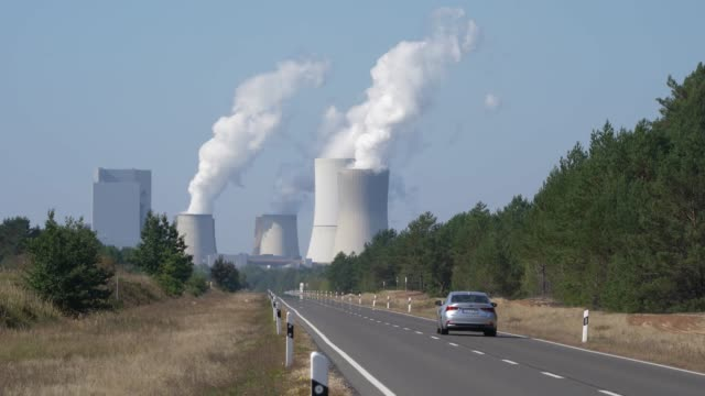 steam rises from cooling towers at the boxberg coal-fired power plant on september 22, 2020 at boxberg, germany. while several mines are still very... - tower stock videos & royalty-free footage