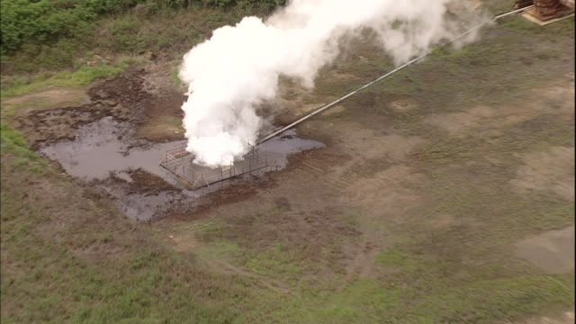 steam rises from fumaroles of sulfur near the runway on iwo jima island, japan. - iwo jima island stock videos & royalty-free footage