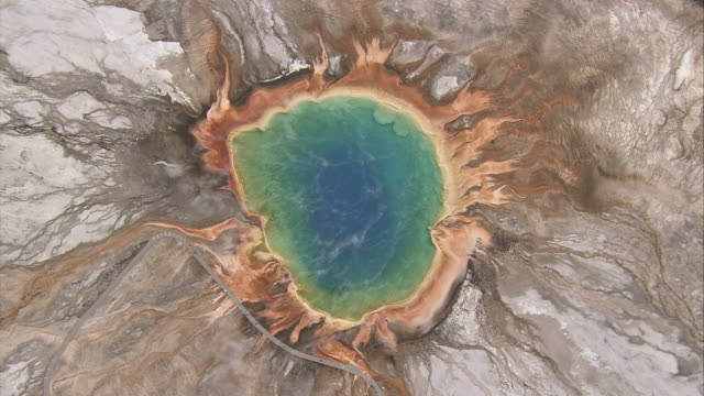 Steam rises from Grand Prismatic Spring in Yellowstone National Park. Available in HD.