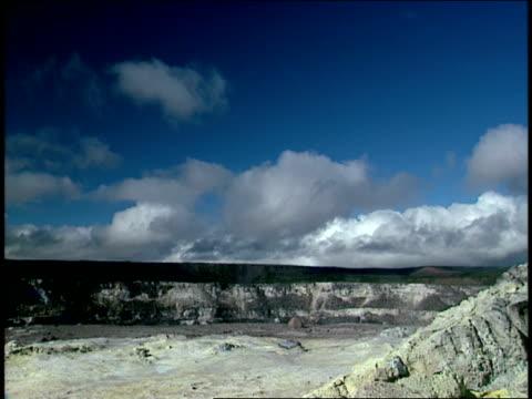 vídeos de stock e filmes b-roll de steam rises from sulfur deposits. - forma de água