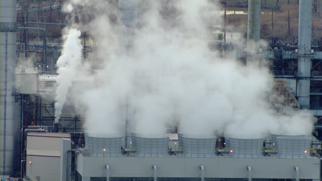 Steam rises from the cooling towers of a power plant in Linden, New Jersey.