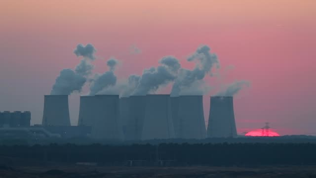 steam rises from the cooling towers of the jaenschwalde coalfired power plant at twilight on october 11 2018 near griessen germany the jaenschwalde... - coal mine stock videos & royalty-free footage