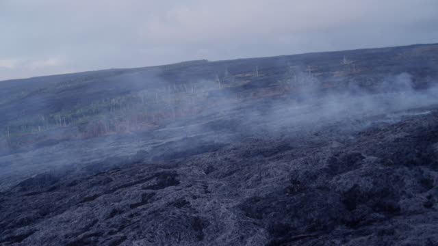steam rises from the pu'u o'o crater in hawaii. - basalt stock videos & royalty-free footage