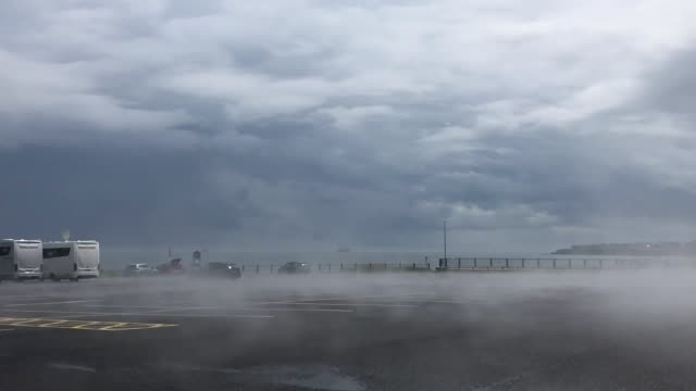 stockvideo's en b-roll-footage met steam rises from the tarmac after the temperature rises after heavy rain in whitley bay - whitley bay