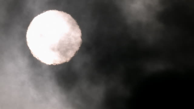 steam rises in front of sun. - smoke physical structure stock videos & royalty-free footage