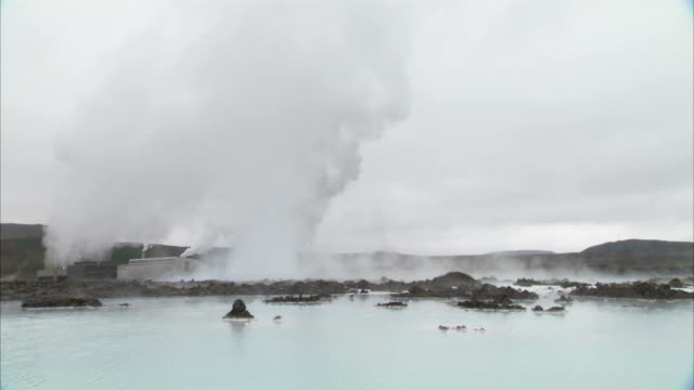 Steam rises off the surface of Blue Lagoon in Iceland. Available in HD