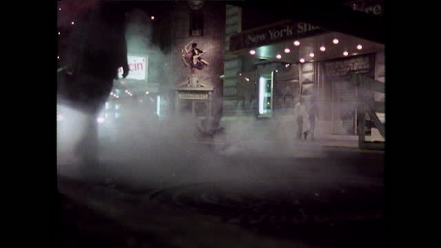 steam rises up from the street on broadway in new york; 1980 - film montage stock videos & royalty-free footage