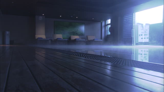 ws steam rising from indoor pool, lounge chairs in distance, woolloomooloo, new south wales - lido stock videos & royalty-free footage
